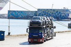 Trucks carrying new cars Royalty Free Stock Image