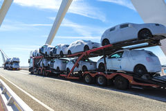 Trucks carrying new cars Royalty Free Stock Images