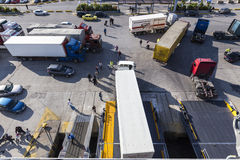 Trucks and cars getting off from ferry coming to Piraeus, Greece Stock Image