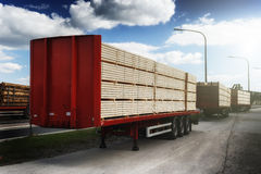 Trucks charged with wood planks Royalty Free Stock Photography