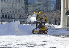 Trucks cleaning snow from streets after blizzard Stock Images