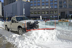 Trucks cleaning snow from streets after blizzard Royalty Free Stock Images