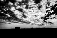 Trucks and construction. Trucks at the landscape of the sunset. Heavy machineries working - transporting something Royalty Free Stock Photo