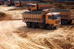 Trucks at construction site Stock Photos