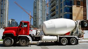 Trucks and construction work. This photograph shows a cement-truck in front of skyscrapers and buildings onder constructure. It shows the modern architecture Stock Photo