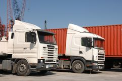 Trucks and containers in port Stock Photos