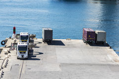 Trucks and containers in the port Stock Photos