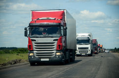 Trucks convoy on the road Stock Image
