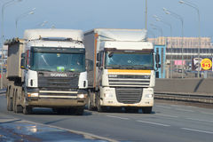 Trucks DAF XF series and Scania 4 series on the Pulkovo highway Royalty Free Stock Photography
