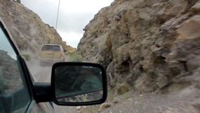 Trucks drive in Canyon stock footage