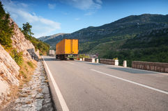 Trucks driving on asphalt mountain road Stock Photography