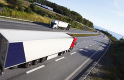 Trucks driving a beautyful freeway route Stock Photo