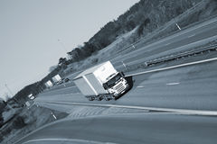 Trucks driving on freeway Stock Photos
