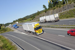 Trucks driving through mountain pass Stock Photo