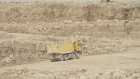 Trucks driving on a road in quarry stock footage