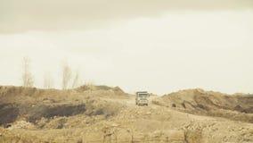 Trucks driving on a road in quarry. Trucks driving on a road in a quarry. 4K stock video