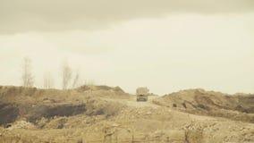 Trucks driving on a road in quarry. Trucks driving on a road in a quarry. 4K stock footage
