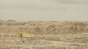 Trucks driving on a road in quarry. Truck carring stones on a road in a quarry stock footage