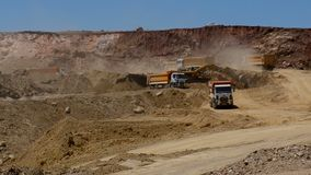 Trucks working in a career. Trucks and excavators working in a career, on mining operations stock video