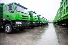 Trucks fleet. A row of trucks in rain Stock Image