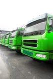 Trucks fleet. A row of trucks in rain Royalty Free Stock Images
