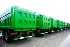 Trucks fleet. A row of trucks in rain Royalty Free Stock Photos