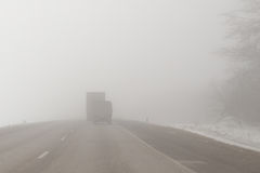 Trucks on a foggy road Royalty Free Stock Image