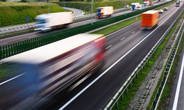 Trucks on four lane controlled-access highway in Poland.  Royalty Free Stock Photography