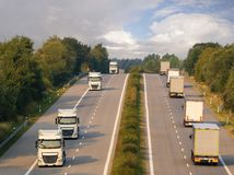 Trucks on the German motorway. Highway with cars and trucs stock photos