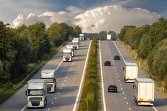 Trucks on the German motorway. Highway with cars and trucs royalty free stock images