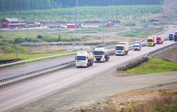 Trucks go on the country highway Royalty Free Stock Photo