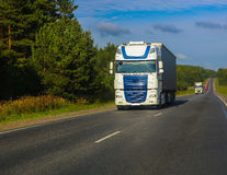 Trucks goes on the highway Stock Photography