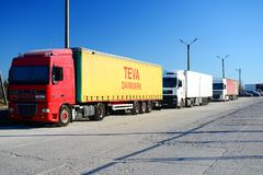 Trucks group in the Vilnius city street Royalty Free Stock Photos