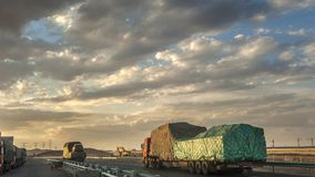 Trucks on highway in the desert Stock Image