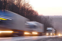 Trucks on a highway Royalty Free Stock Image