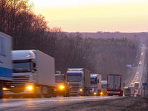 Trucks on a highway Royalty Free Stock Images