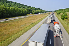 Trucks on the Interstate Highway Royalty Free Stock Photo