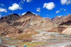 Trucks in Ladakh. View on road with trucks in the valley on the way from Manali to Leh Royalty Free Stock Photos
