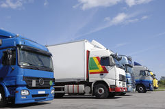 Trucks line up for loading Royalty Free Stock Image