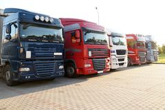 Trucks lit by the setting sun. Travel plaza. Filled with lorries royalty free stock photo