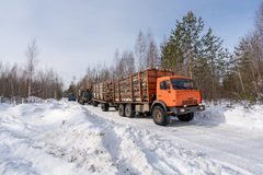 Trucks loaded with timber move out of woods Stock Images