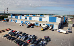 Trucks are loaded and unloaded at a large warehouse, top view of the warehouse and parking loading and unloading. Royalty Free Stock Photo