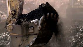 Trucks loading coal ina coal mine. Detail of trucks in a coal mine stock video