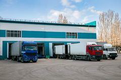 Trucks loading in warehouse for cargo transportation royalty free stock images