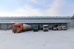 Trucks are on the loading at the warehouse Royalty Free Stock Photography