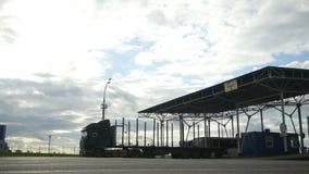 Trucks Lorries and Buses Drive Through Checkpoint. KAZAN, TATARSTAN/RUSSIA - JUNE 08 2015: Trucks lorries and buses drive through checkpoint in summer evening stock footage