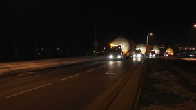 Trucks or lorries with oversized cargoes at night. Trucks or lorries with oversized cargoes and flashers at night stock video footage