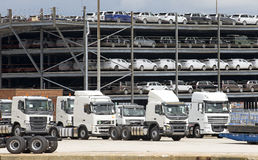 Trucks and luxury cars await export from docks UK Royalty Free Stock Photography