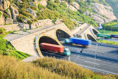 Trucks motion blur in tunnel exit Stock Photo