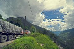 Trucks on mountain road. Landscape view of the border between Nepal and Tibet Stock Image